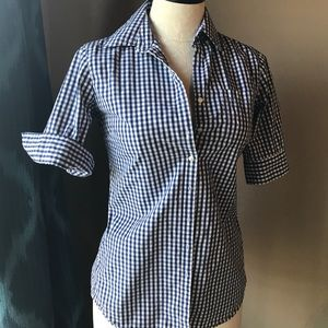 Gingham blouse with button accent in back